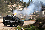 A view shows an Israeli military vehicle during clashes following demonstration demanding the release of the prisoner Lena Khattab held in Israeli jails outside Israel's Ofer military prison near the West Bank city of Ramallah on February 28, 2015. Photo by Shadi Hatem