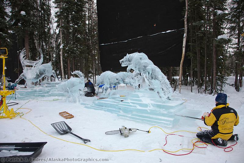 "Japan team members work on the multi block sculpture titled ""White Fang"" for the 2009 World Ice Art Championships in Fairbanks, Alaska. Team members: Junichi Nakamura, Shinichi Sawamura, Fukumi Furukawa, Takao Waki."