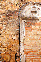 Details of an ancient wall in the historic centre of San Quirico D' Orcia, a Unesco World Heritage listed site, Tuscany, Italy