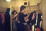 Paul McCartney Wing Tour 1973. Wardrobe designer Paul chooseing clothes to wear. 1970s UK