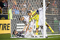 Real Salt Lake goalkeeper Nick Rimando (18) helps Ned Grabavoy (20) out of the net. The Philadelphia Union and Real Salt Lake played to a 0-0 tie during a Major League Soccer (MLS) match at PPL Park in Chester, PA, on August 24, 2012.