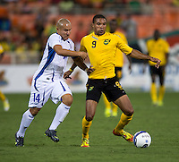 Dennis Alas (14) of El Salvador tries to take ball away from Ryan Johnson (9) of Jamaica at RFK Stadium in Washington, DC.  Jamaica defeated El Salvador, 2-0.