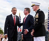 WASHINGTON DC - SEPTEMBER 11: United States President Barack Obama, left, with US Secretary of Defense Ash Carter, center, and US Marine Corps General Joseph F. Dunford Jr., Chairman of the Joint Chiefs of Staff, right, at the Pentagon Memorial in Washington, DC during an observance ceremony to commemorate the 15th anniversary of the 9/11 terrorist attacks, Sunday, September 11, 2016.<br /> Credit: Dennis Brack / Pool via CNP/MediaPunch
