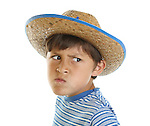 Young boy has a mad face while wearing a cowboy hat on a white background