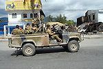Australian Special Forces tackle rival gangs as they clash at the bridge in the Comora area of Dili, a hot point for clashes between rival gangs, the ( Lorosae) and the Westerners (Loromonu). Much of the violence is tat for tat revenge for the lotting and burning of homes. 05/06/06 East Timor