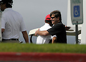Kailua, Hawaii - December 29, 2008 -- United States President-elect Barack Obama (left) and friend Greg Orme (right) hug before warming up on the driving range to play golf with friends in Kailua, Hawaii on Monday, December 29, 2008. Obama and his family arrived in his native Hawaii December 20 for the Christmas holiday..Credit: Joaquin Siopack - Pool via CNP