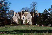 A Jacobean country house glimpsed from a neighbouring field