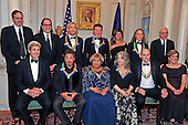 The five recipients of the 39th Annual Kennedy Center Honors pose for a group photo following a dinner hosted by United States Secretary of State John F. Kerry in their honor at the U.S. Department of State in Washington, D.C. on Saturday, December 3, 2016.  The 2016 honorees are: Argentine pianist Martha Argerich; rock band the Eagles; screen and stage actor Al Pacino; gospel and blues singer Mavis Staples; and musician James Taylor. From left to right back row: Ricky Kirshner, Glenn Weiss, Joe Walsh, Don Henley, Cindy Frey, wife of Glenn Frey, who passed away earlier this year, and Timothy B. Schmidt of the rock band &quot;The Eagles&quot;  and David M. Rubenstein, Chairman, John F. Kennedy Center for the Performing Arts.  Front row, left to right: United States Secretary of State John Kerry, Al Pacino, Mavis Staples, Martha Argerich, James Taylor and Deborah F. Rutter, President of the John F. Kennedy Center for the Performing Arts.<br /> Credit: Ron Sachs / Pool via CNP