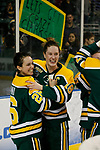 ST CHARLES, MO - MARCH 19:  Kelly Mariani (26) and Cayley Mercer (18) of the Clarkson Golden Knights celebrate the Clarkson victory over the Wisconsin Badgers to win the Division I Women's Ice Hockey Championship held at The Family Arena on March 19, 2017 in St Charles, Missouri. Clarkson defeated Wisconsin 3-0 to win the national championship. (Photo by Mark Buckner/NCAA Photos via Getty Images)