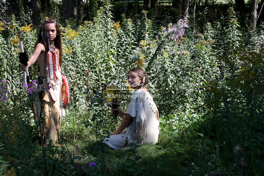 Native American Indian boy and girl in the woods sharing a romantic moment