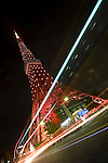 Tokyo Tower/the Tokyo Metropolitan Government offices are illuminated with red lights to mark World AIDS Day in Tokyo, Japan on Tuesday Nov. 30 2010..Photographer: Robert Gilhooly