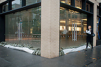 "Sandbags are used to protect the entrance to the closed Apple store in the Meatpacking District in New York on Monday, October 29, 2012. Hurricane Sandy continues its steady advance with heavy wind and rain. New York has shut down the schools, the transit system and the Holland and Hugh L. Carey Tunnels have been closed. Evacuations have been ordered in the ""Zone A"" areas including Battery park City. (© Richard B. Levine)"