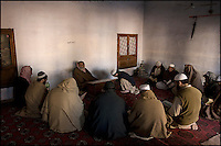 students attend an evening arabic prononciation class with their teacher at the darol uloom sarhad madrassa in peshawar