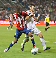 CARSON, CA – July 2, 2011: Chivas USA forward Victor Estupinan (99) and Chicago Fire defender Gonzalo Segares (13) during the match between Chivas USA and Chicago Fire at the Home Depot Center in Carson, California. Final score Chivas USA 1, Chicago Fire 1.
