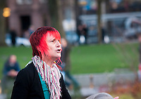 One of the activists at Occupy Edinburgh, talking about the movement, St Andrew Square, Edinburgh, Scotland