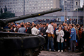 Moscow, Soviet Union<br /> August 21, 1991<br /> <br /> Pro-Yeltsin supporters oppose tanks at the Parliament building barricades during the Soviet coup d'&eacute;tat attempt (August 19-21, 1991), also known as the August Putsch or August Coup. A small group of the Soviet government officials briefly deposed president Mikhail Gorbachev in an attempted to take control of the country. The coup leaders were hard-line members of the Communist Party (CPSU) who felt that Gorbachev's reforms had gone too far in dispersing the central government's power to the republics - better known as perestroika. The coup collapsed in three days, and Gorbachev returned to power, crushing the Soviet leader's hopes that the union could be held together in a decentralized form.