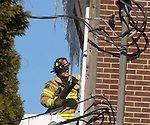 WATERBURY, CT-11 February 2014-0201114BF01- Waterbury Fire Department firefighters worked to contain an apartment fire at a condo complex on Waterville Street Tuesday morning. No injuries to residents or firefighters were reported.  Bob Falcetti Republican-American