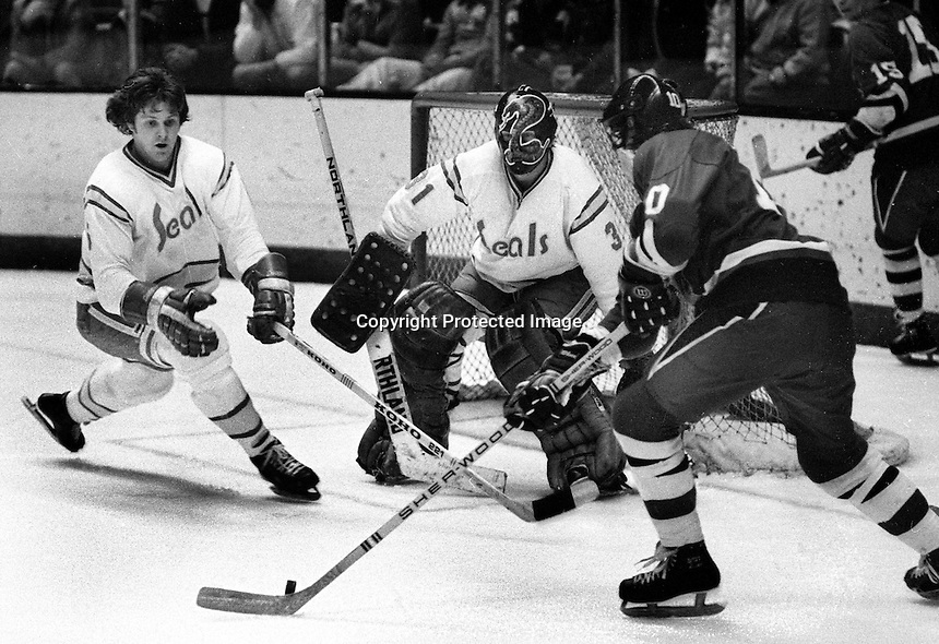 California Golden Seals Len Frig and goalie Gary Simmons &quot;The Cobra&quot; defend North Stars.<br />(photo 1976 by Ron Riesterer)