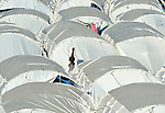 """Carrying water, a woman walks through a """"tent city"""" for homeless families set up in the Belair neighborhood of Port-au-Prince, Haiti, in the wake of a devastating earthquake that shook the Caribbean island nation on January 12."""