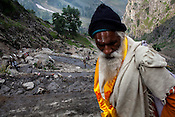 Hindu pilgrims walk along the mountain trail to climb the first pass, Pissu Top (11500ft) enroute to the pilgrimage to Amarnath in Kashmir, India. Hindu pilgrims brave sub zero temperature and high latitude passes and make their pilgrimage to reach the sacred Amarnath cave, which houses a lingam - a stylized phallus, worshiped by Hindus as a symbol of God Shiva. Photo: Sanjit Das/Panos