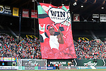 """19 June 2015: Portland's supporters group, the Rose City Riveters, raise a large banner reading """"Win Locally"""" before the game. The Portland Thorns FC hosted FC Kansas City at Providence Park in Portland, Oregon in a National Women's Soccer League 2015 regular season match. The game ended in a 1-1 tie."""