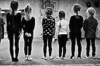 Girls age 4 and 5 prepare for rhythmic gymnastics training at the Dinamo Sports Palace in Moscow, Russia. The girls have been training for about 3 months.