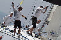 Jesper Radich and crew prepare to drop the spinnaker during the quarter finals of Match Race Germany 2010. World Match Racing Tour. Langenargen, Germany. 23 May 2010. Photo: Gareth Cooke/Subzero Images/WMRT