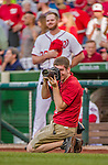 22 May 2015: Washington Nationals Team Photographer Patrick McDermott takes photos during a pre-game stand-off between Philadelphia Phillies pitcher Aaron Harang (not pictured) and Nationals pitcher Aaron Barrett (background) prior to a game at Nationals Park in Washington, DC. The Nationals defeated the Phillies 2-1 in the first game of their 3-game weekend series. Mandatory Credit: Ed Wolfstein Photo *** RAW (NEF) Image File Available ***