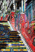 View of Selaron's Stairs (Escadaria Selarón), a mosaic staircase made of colorful tiles, in Rio de Janeiro, Brazil, 15 February 2012. World-famous staircase, mostly covered by vibrant yellow, green and blue tiles (inspired by the colors of the Brazilian flag), is the masterpiece of Chilean-born artist Jorge Selarón who considers it as a personal tribute to the Brazilian people. Connecting the neighborhoods of Santa Teresa and Lapa, the stairway is made up of 250 steps and measures 125 meters long. In 1990 Selarón began work on the stairway, creating a constantly evolving piece of art, now adorned with over 2,000 brightly colored tiles collected from over 60 countries. Selarón funds his one man's project through donations and the sale of his black-and-red paintings which mostly depict a pregnant African woman or himself. Living his passion, the eccentric 65-year-old artist claims that this crazy and unique dream will only end on the day of my death.