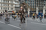 The Tweed Run London UK. Cyclists ride around Parliament Square.