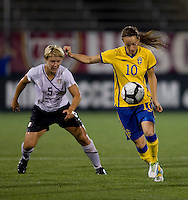 Lori Lindsey (5) of the USWNT tries to contain Kosovare Asllani (10) of Sweden at Rentschler Field in East Hartford, Connecticut.  The USWNT defeated Sweden, 3-0.