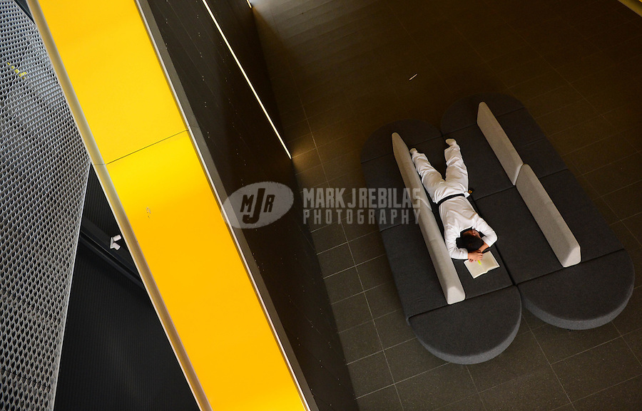 Aug 10, 2012; London , United Kingdom; A taekwondo competitor sleeps on a bench outside of the ExCeL - South Arena 1 during the London 2012 Olympic Games. Mandatory Credit: Mark J. Rebilas-USA TODAY Sports