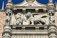 The 14th Century Gothic style statues of the Doge & the winger lion of St Mark on the south facade of The Doge's Palace, Palazzo Ducale, Venice Italy