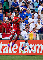 Luis Henriquez (17) of Panama goes up for a header with Xavier Garcia (2) of El Salvador  during the game at RFK Stadium in Washington, DC.  Panama defeated El Salvador on penalty kicks, 5-3, after tying, 1-1,  in regulation time.