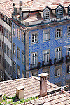 A building in the historical city center of Porto, Portugal with azulejos - blue and white decorative tiles traditional to Portuguese architecture.