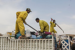 10/10/2014 -- Kirkuk, Iraq -- Bangladeshi workers trow the trash from the trash car after they cleaned the streets.