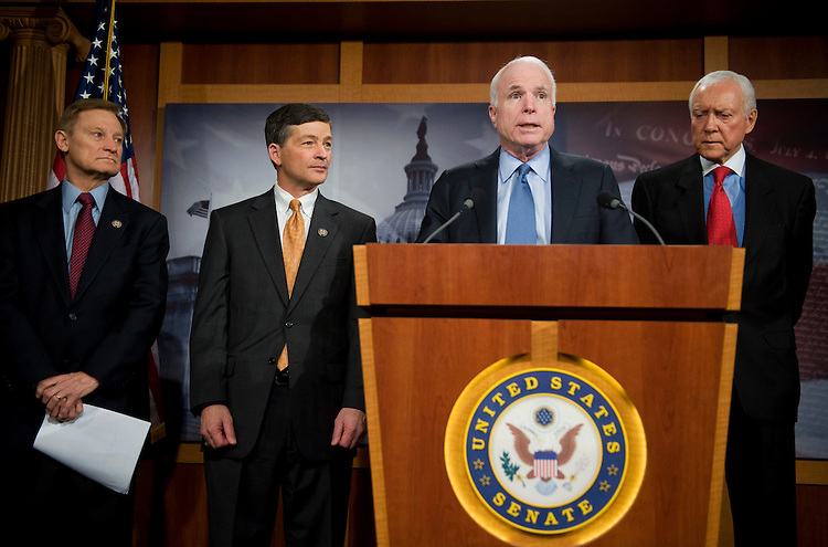 """UNITED STATES - MARCH 31:  From left, Reps. Spencer Bachus, R-Ala., Jeb Hensarling, R-Texas, Sen. John McCain, R-Ariz., and Sen. Orrin Hatch, R-Utah, conduct a news conference in the Capitol on the """"Government Sponsored Enterprise Bailout Elimination and Taxpayer Protection Act,"""" that would stop taxpayer-funded bailouts of Fannie Mae and Freddie Mac.  (Photo By Tom Williams/Roll Call)"""