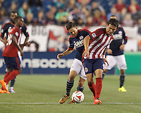 Foxborough, Massachusetts - August 23, 2014: First half action. In a Major League Soccer (MLS) match, the New England Revolution (white) vs Chivas USA (red/blue), 0-0 (halftime), at Gillette Stadium.