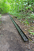 A piece of railroad track from the East Branch & Lincoln Railroad (1893-1948) along the Bondcliff Trail in the Pemigewasset Wilderness of New Hampshire. This short section of trail follows the old Black Brook spur line at Camp 16.