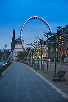Waterfront cafes and restaurants with ferris wheel in Dusseldorf, Germany