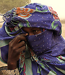 A displaced woman in Labado weeps as she tells the story of how the Janjaweed attacked her village. More than 2.5 million Darfur residents have been displaced since 2003 by a coalition of government forces and Arab militias..