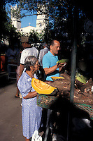 People shopping for fruit and produce at an outdoor market in the city of David, Chiriqui province, Panama
