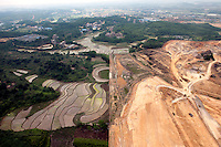 Agricultural land and rice fields next to land being cleared in the city of Nanning. /Felix Features