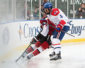 Adam Reid (NU - 8), Joe Houk (UML - 4) - The Northeastern University Huskies defeated the University of Massachusetts Lowell River Hawks 4-1 (EN) on Saturday, January 11, 2014, at Fenway Park in Boston, Massachusetts.