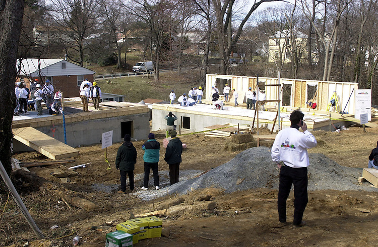 """19hfh030701 -- The grounds of a Habitat for Humanity event the""""U.S. Senators Build"""", in which Senators, from both sides, and their spouses worked on raising two house in Capitol Heights, MD."""