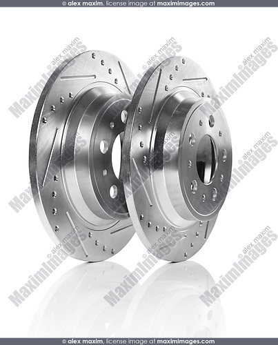 Car brake discs, two rotors isolated on white background. Automotive parts still life.