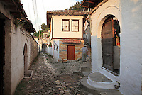 Man in a narrow street amongst the houses in the Gorica Quarter in Berat, South-Central Albania, capital of the District of Berat and the County of Berat. Picture by Manuel Cohen