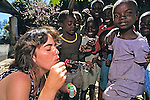 Jacqueline Points Blowing Bubbles For Children