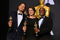 Adele Romanski, Jeremy Kleiner &amp; Barry Jenkins in the photo room at the 89th Annual Academy Awards at Dolby Theatre, Los Angeles, USA 26 February  2017<br /> Picture: Paul Smith/Featureflash/SilverHub 0208 004 5359 sales@silverhubmedia.com