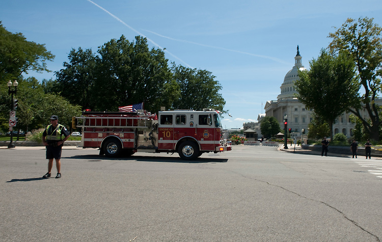 UNITED STATES - AUGUST 23: A DC Fire truck speeds past the Capitol down Constitution Avenue after a magnitude 5.9 earthquake struck the Washington area on Tuesday, Aug. 23, 2011. (Photo By Bill Clark/Roll Call)